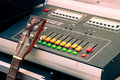 Soundboard with a guitar music concept mixer Royalty Free Stock Photo
