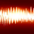 Soundwave bright sound wave on a soft red background Stock Photography