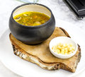 Soup with beans and mushrooms garnished with goat cheese Stock Photos