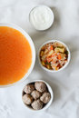 Soup with ingredients a bowl of its next to it Stock Image