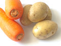 Soup ingredients carrots and potatoes for Royalty Free Stock Photos