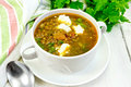 Soup lentil with spinach and cheese on light board Royalty Free Stock Photo