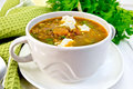 Soup lentil with spinach and feta on board Royalty Free Stock Photo