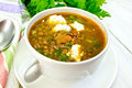 Soup lentil with spinach and feta on light board Royalty Free Stock Photo