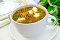 Soup lentil with spinach and feta in white cup on board Royalty Free Stock Photo