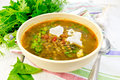 Soup lentil with spinach and feta in yellow bowl on board Royalty Free Stock Photo
