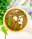 Soup lentil with spinach on light board top Royalty Free Stock Photo
