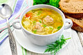 Soup with meatballs and noodles in bowl on board Royalty Free Stock Photo