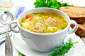 Soup with meatballs and noodles in bowl on saucer Royalty Free Stock Photo