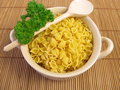 Soup noodles and parsley in cup Royalty Free Stock Photo