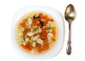 Soup on plate and spoon Stock Photo