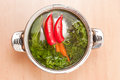 Soup preparation shot of shiny metal pot filled with water and ingredients Royalty Free Stock Image