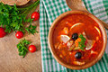 Soup solyanka Russian with meat, olives and gherkins Royalty Free Stock Photo