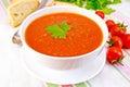 Soup tomato in bowl on linen napkin Royalty Free Stock Photo