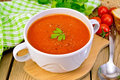 Soup tomato in bowl with spoon on board Royalty Free Stock Photo
