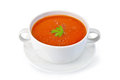 Soup tomato with parsley in white bowl on saucer Royalty Free Stock Photo