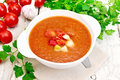 Soup tomato in white bowl on light board Royalty Free Stock Photo