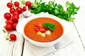 Soup tomato in white bowl with vegetables on napkin Royalty Free Stock Photo