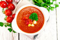 Soup tomato in white bowl with vegetables and parsley on board t Royalty Free Stock Photo