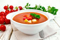 Soup tomato in white bowl with vegetables on towel Royalty Free Stock Photo