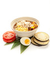 Soup traditional japanese dish of cold in a white plate on a white background decorated with fresh tomato boiled egg and eggplant Stock Image