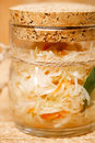 Sour cabbage sauerkraut in glass jar clouseup Stock Photography