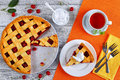 Sour cherry pie, whipped cream and tea Royalty Free Stock Photo