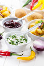 Sour cream and chutney with baked potatoes Stock Image