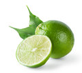 Sour lime with green leaves isolated on white background Royalty Free Stock Photo