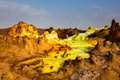 Sour river and mountains in Danakil depression, Ethiopia. Royalty Free Stock Photo
