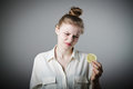 Sour taste young slim woman with lemon Royalty Free Stock Photos