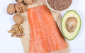 Sources of omega fatty acids flaxseeds avocado salmon and walnuts Royalty Free Stock Image
