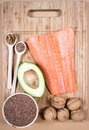 Sources of omega fatty acids flaxseeds avocado salmon and walnuts Stock Images
