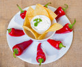 Sourcream with corn chips and red hot chilli peppers. Royalty Free Stock Photo