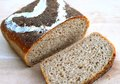 Sourdough bread fresh slice of healthy homemade made from rye oats and wheat flour plus sunflower and sesame seeds Stock Images