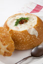 Sourdough bun of delicious hot clam chowder garnished with bacon and dill Stock Image