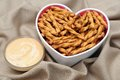 Sourdough nuggets pretzel in heart shape bowl on cloth Stock Photo