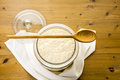 Sourdough starter in large glass jar on the table Royalty Free Stock Photography