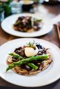 Sourdough toasted bread with mushrooms and asparagus Royalty Free Stock Photo
