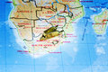 South Africa on map with miniature trolley, diamond mining concept