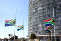 South african flags flying at half mast durban africa december in honor of nelson mandela in durban africa on december Royalty Free Stock Photo