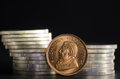 South African Gold Coin Krugerrand infront of Silver Coins Royalty Free Stock Photo
