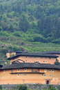 South chinese traditional residence earth castle among mountains the of hakka in fujian of china whcih has over one thousand years Stock Photos