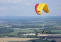 South downs parascending people off of the near firle east sussex Stock Photography