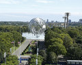 South gate at USTA Billie Jean King National Tennis Center and 1964 New York World s Fair Unisphere in Flushing Meadows Park Royalty Free Stock Photo