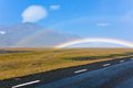 South icelandic mountain landscape under blue bright sky double rainbow Stock Image