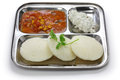 South indian breakfast on stainless steel plate idli sambar and coconut Stock Photo