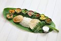 South indian meals served on banana leaf traditional cuisine Stock Photo