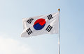South Korea flag waving with blue sky in background. Royalty Free Stock Photo