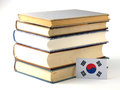 South Korean flag with pile of books isolated on white backgroun Royalty Free Stock Photo